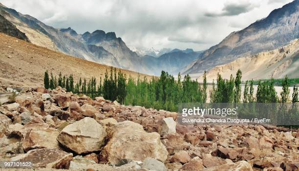 scenic view of rocky mountains against sky - extreme terrain stock pictures, royalty-free photos & images