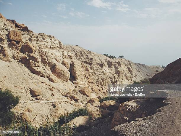 Scenic View Of Rocky Mountains At Ein Gedi Against Sky