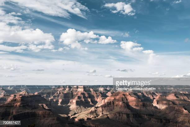 Scenic View Of Rocky Mountains At Grand Canyon National Park Against Sky