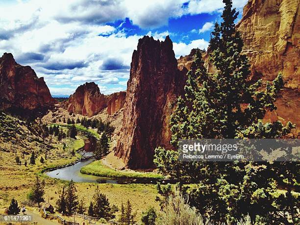 scenic view of rocky mountains at smith rock state park against sky - smith rock state park stock pictures, royalty-free photos & images