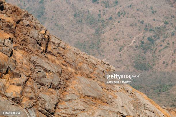 scenic view of rocky mountains - junagadh stock photos and pictures