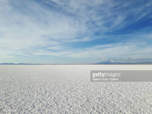 scenic view of salar de uyuni against blue sky - salt flat stock pictures, royalty-free photos & images