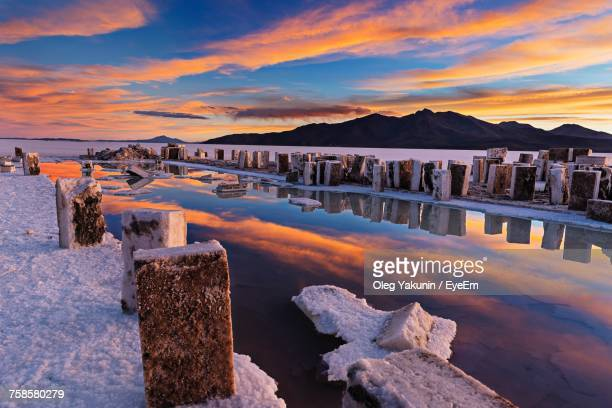Scenic View Of Salt Lake At Salar De Uyuni Against Sky During Sunset