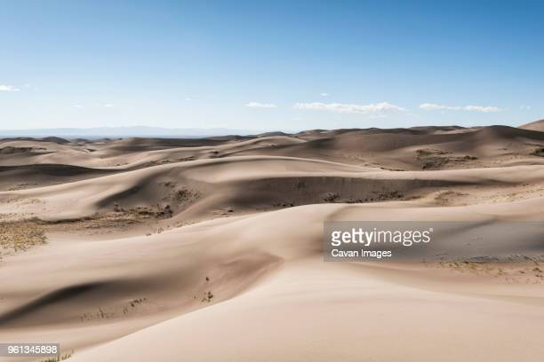 scenic view of sand dunes against sky - great sand dunes national park stock pictures, royalty-free photos & images