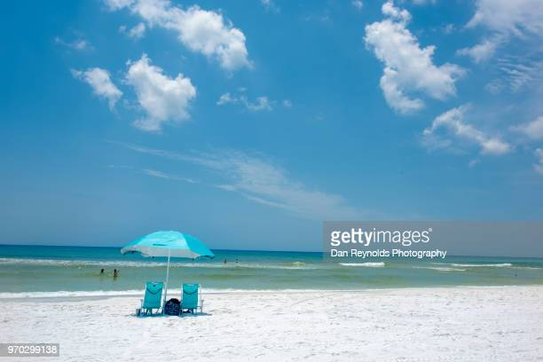 scenic view of sand dunes and sea against sky - pensacola beach stock pictures, royalty-free photos & images