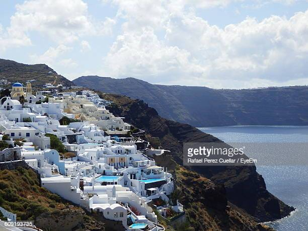Scenic View Of Santorini By Aegean Sea Against Mountains