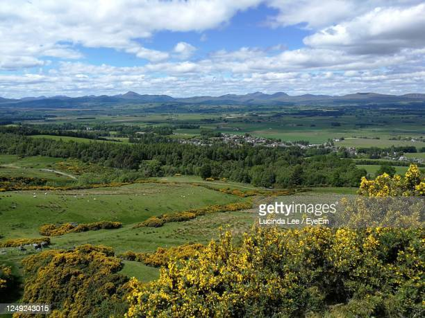 scenic view of scottish valley against sky - lucinda lee stock pictures, royalty-free photos & images