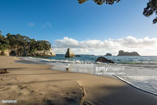 Scenic View Of Sea Against Blue Sky At Cathedral Cove