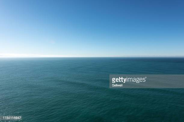 scenic view of sea against blue sky, at nugget point lighthouse - lookout tower stock pictures, royalty-free photos & images