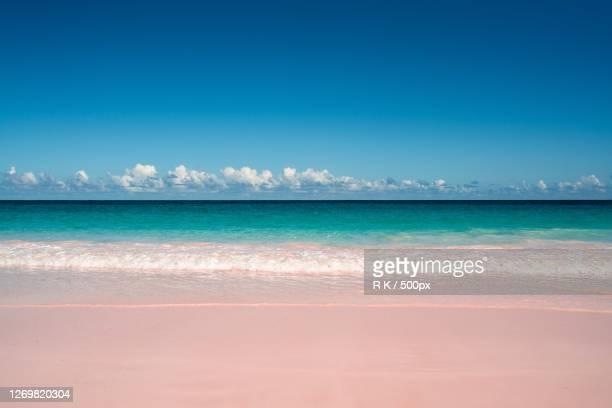 scenic view of sea against blue sky, dunmore town, bahamas - ダンモアタウン ストックフォトと画像