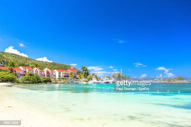 scenic view of sea against blue sky during sunny day - jamaica stock pictures, royalty-free photos & images