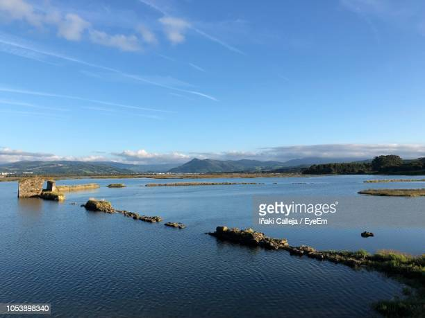 scenic view of sea against blue sky - iñaki mt stock photos and pictures