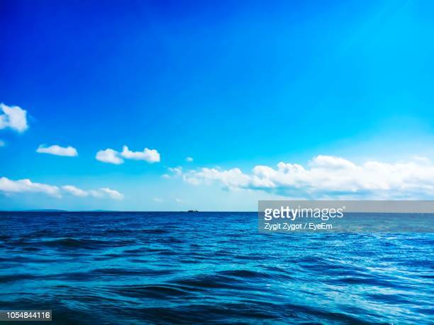 scenic view of sea against blue sky - 水平線 ストックフォトと画像