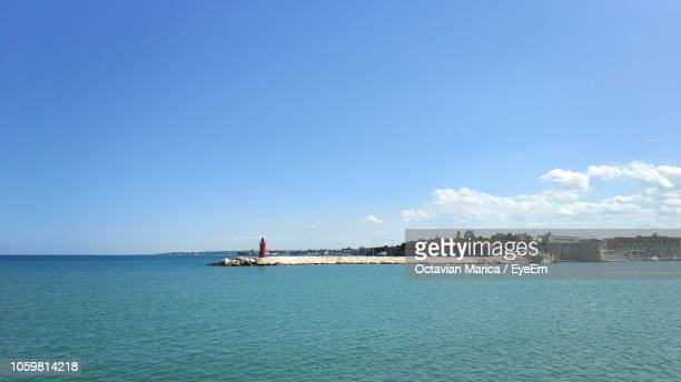 scenic view of sea against blue sky - marica octavian stock photos and pictures