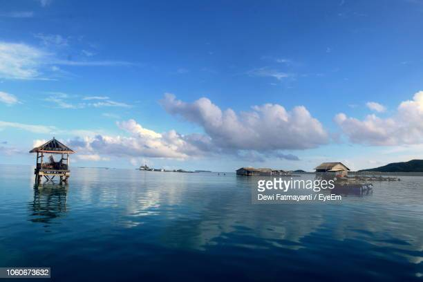 scenic view of sea against blue sky - dewi fatmayanti stock photos and pictures