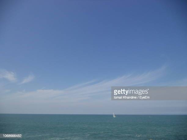 scenic view of sea against blue sky - ismail khairdine stock photos and pictures