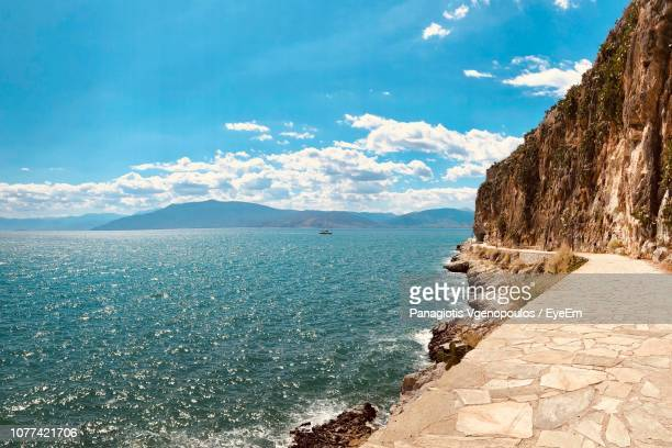 scenic view of sea against blue sky - vgenopoulos stock pictures, royalty-free photos & images