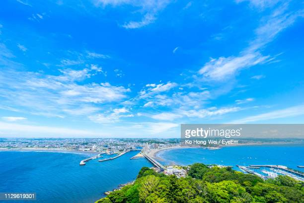 scenic view of sea against blue sky - 空 ストックフォトと画像