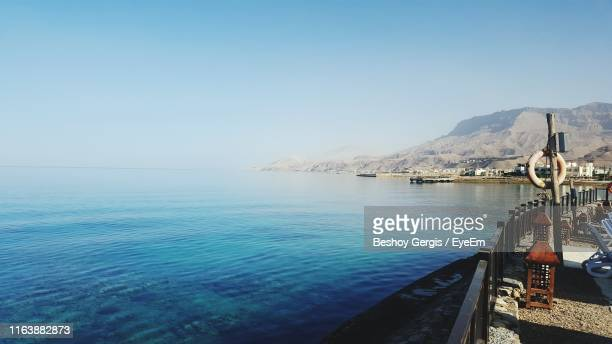 scenic view of sea against blue sky - red sea stock pictures, royalty-free photos & images