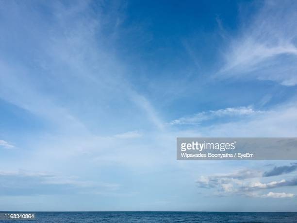 scenic view of sea against blue sky - wipavadee stock photos and pictures