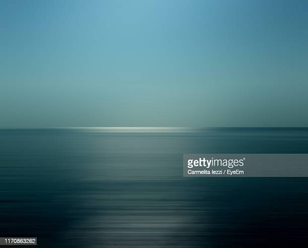 scenic view of sea against blue sky - carmelita iezzi stock pictures, royalty-free photos & images