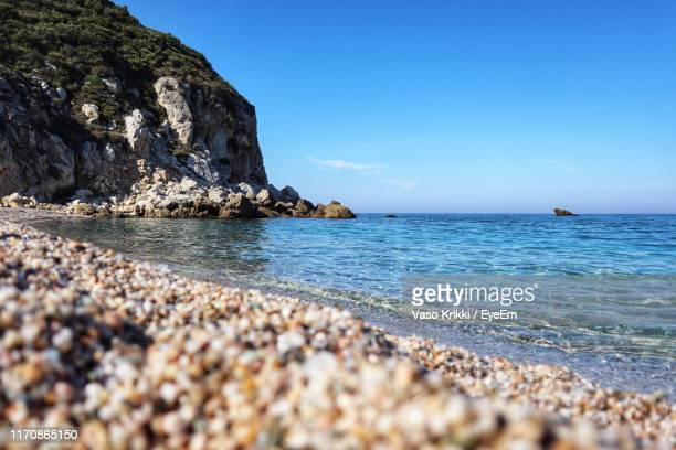 scenic view of sea against blue sky - vaso stock pictures, royalty-free photos & images