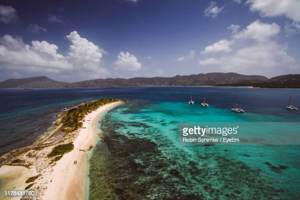 scenic view of sea against blue sky - west indies stock pictures, royalty-free photos & images