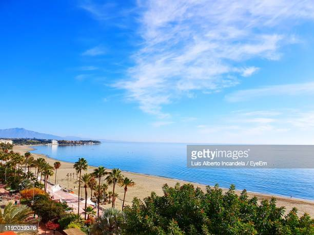 scenic view of sea against blue sky - málaga málaga province stock pictures, royalty-free photos & images