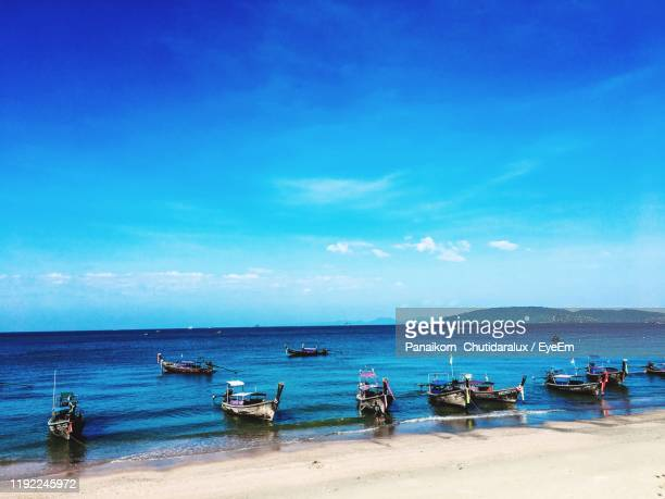 scenic view of sea against blue sky - panaikorn chutidaralux stock photos and pictures