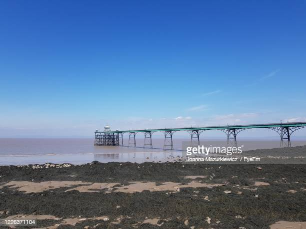 scenic view of sea against blue sky - clevedon pier ストックフォトと画像