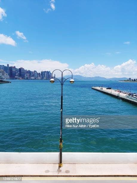 scenic view of sea against blue sky - tsim sha tsui stock pictures, royalty-free photos & images