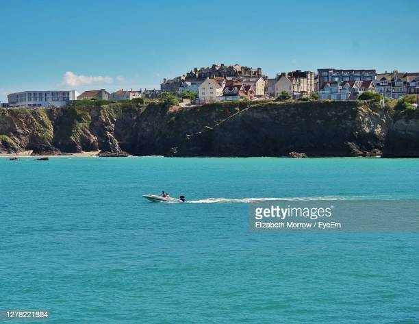 scenic view of sea against blue sky - newquay stock pictures, royalty-free photos & images