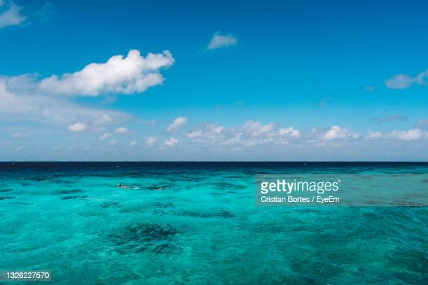 scenic view of sea against blue sky - bortes stock pictures, royalty-free photos & images