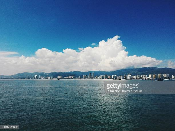 scenic view of sea against blue sky - hakimi stock photos and pictures