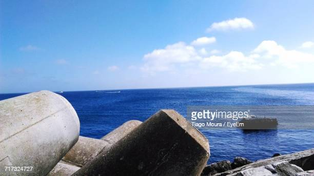 scenic view of sea against blue sky - moura stock photos and pictures