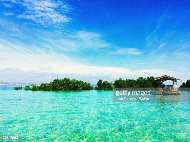 scenic view of sea against blue sky - davao city stock photos and pictures