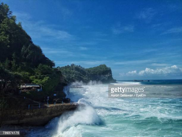 scenic view of sea against blue sky - east java province stock photos and pictures