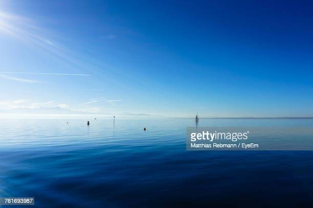 scenic view of sea against blue sky - bodensee stock-fotos und bilder