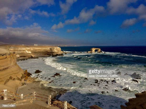 scenic view of sea against blue sky - antofagasta region stock photos and pictures