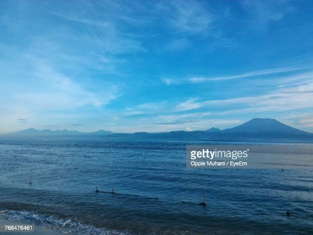 scenic view of sea against blue sky - oppie muharti stock pictures, royalty-free photos & images