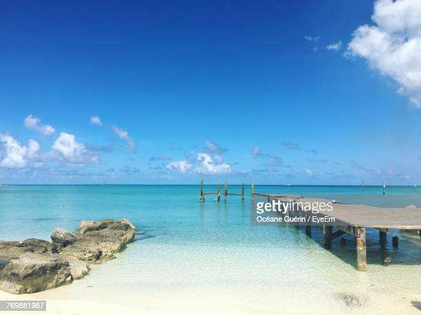scenic view of sea against blue sky - nassau stock photos and pictures