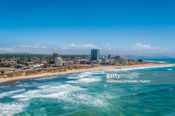 scenic view of sea against blue sky - port elizabeth südafrika stock-fotos und bilder