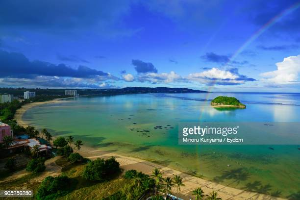 scenic view of sea against blue sky - guam stock pictures, royalty-free photos & images