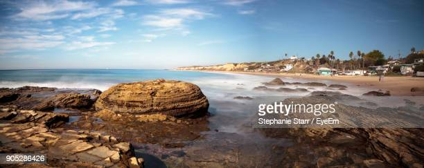 scenic view of sea against blue sky - newport beach california stock photos and pictures