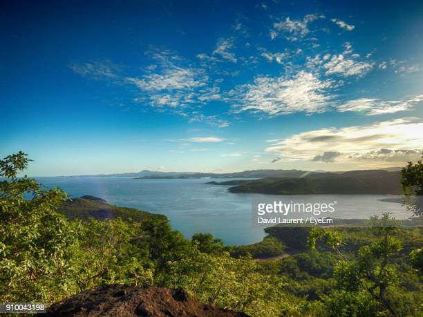 scenic view of sea against blue sky - martinique stock photos and pictures