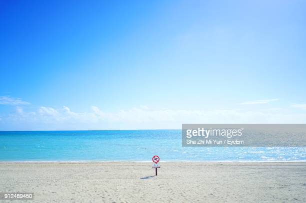 scenic view of sea against blue sky - 砂 ストックフォトと画像