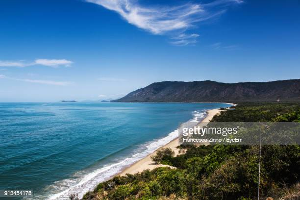 scenic view of sea against blue sky - cairns stock photos and pictures