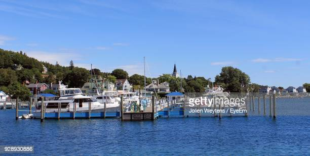 scenic view of sea against blue sky - mackinac island stock pictures, royalty-free photos & images