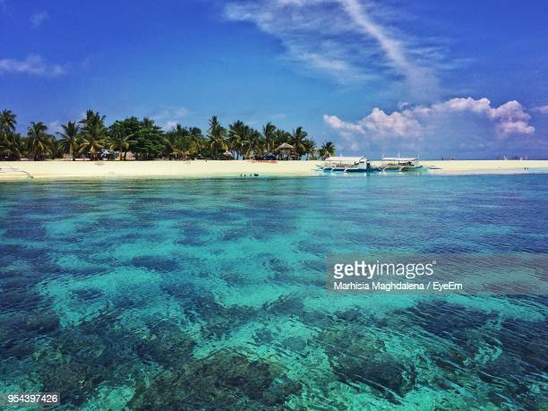 scenic view of sea against blue sky - cebu stock photos and pictures