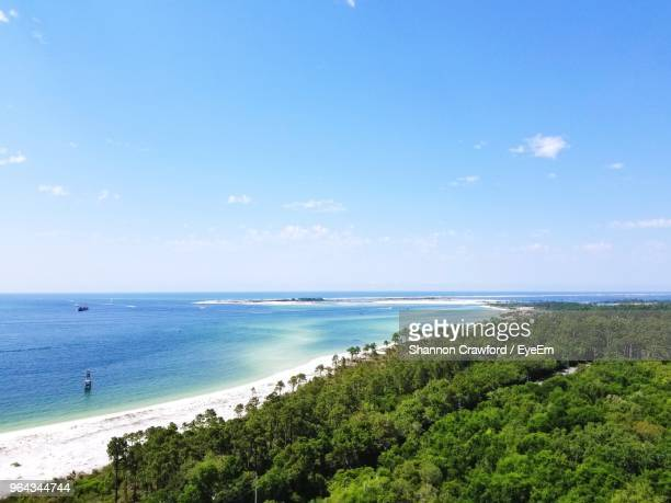 scenic view of sea against blue sky - pensacola beach stock pictures, royalty-free photos & images